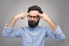 Thinking man touching head stock photography