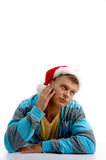 Thinking man wearing christmas hat. Against white background Royalty Free Stock Images