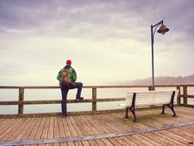 Thinking man on wooden pier on background of sea royalty free stock photos
