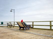 Thinking man on wooden pier on background of sea royalty free stock images