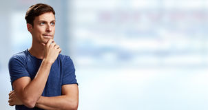 Thinking man. Thinking young man portrait over abstract background royalty free stock photo