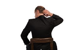 Thinking Manager. A Manager is sitting on a chair and thinking isolated on a white background Stock Photos