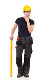 Thinking manual worker with a measuring instrument Stock Image