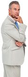 Thinking mature businessman holding glasses Royalty Free Stock Photos