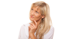 Thinking mature woman looking up isolated Royalty Free Stock Photos