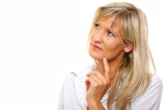 Lovely mature woman looking away in thought. Stock Image