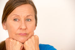 Thinking mature woman worried look Royalty Free Stock Photos