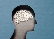 Thinking Mechanism. Human head with brain shaped with gears Royalty Free Stock Photo