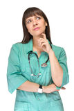 Thinking medical doctor woman looking up Royalty Free Stock Photography