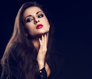 Thinking melancholy female model with long brown hair posing in Royalty Free Stock Image