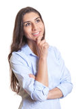 Thinking mexican businesswoman Stock Photography