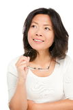 Thinking middle aged asian woman. Thinking middle aged mature Asian woman looking up at copy space. Pensive mid age Chinese asian woman in her early 50s isolated Royalty Free Stock Photography