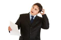 Thinking modern businessman holding document Royalty Free Stock Photos