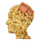 Thinking Movies. Concept and movie guide or reviews symbol as a heap of popcorn shaped as a human head with ticket stubs emerging as an icon for entertainment Royalty Free Stock Photos