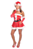 Thinking Mrs Claus. Santa's sexy blond helper standing with her chin in her hand Royalty Free Stock Photos