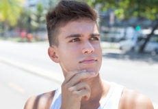 Thinking muscular guy in the city Stock Photography