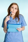 Thinking Nurse Stock Photo