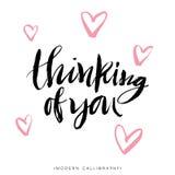 Thinking Of You. Modern Brush Calligraphy. Handwritten Lettering. Stock Photo