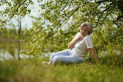 Thinking old woman Royalty Free Stock Photography