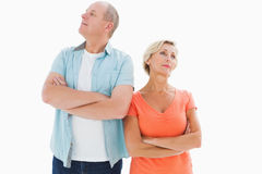 Thinking older couple with arms crossed Royalty Free Stock Photos