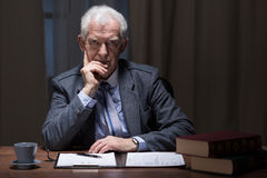 Thinking older man. Older elegant man thinking in his vintage study room Stock Photo