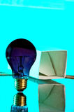 Thinking out of the box 2. Black light bulb. out of it's box stock photos