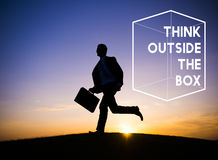 Thinking Out Of The Box Concept. Businessman running dawn field think outside the box word royalty free stock photo