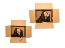 Thinking outside of the box. Business woman, thinking outside of the box royalty free stock photo