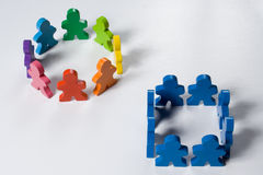 Thinking Outside the Box. Multicolored wooden people illustrating a business concept Royalty Free Stock Photos