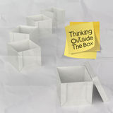 Thinking outside the box on crumpled sticky note paper Stock Photo