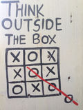 Thinking outside the box in a white blackboard stock photography