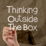 Thinking outside te box on crumpled paper Stock Image