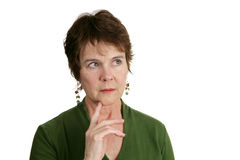 Thinking It Over. A pretty, mature Irish woman lost in thought.  Isolated on white Stock Image