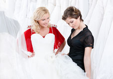 Thinking over a wedding gown Royalty Free Stock Photos