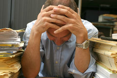 Thinking overload. This man worked to hard. Or could be sleeping. Who shall say stock photo