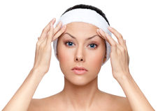 Thinking about plastic surgery. Isolated, white background Royalty Free Stock Photos
