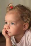 Thinking. Portrait of the thinking child Royalty Free Stock Image