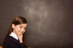 Thinking pupil looking at camera Stock Photography