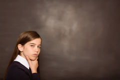 Thinking pupil looking at camera Stock Images