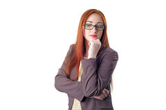 Thinking redhead business woman with glasses Stock Photography
