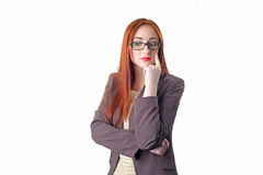 Thinking redhead business woman with glasses Royalty Free Stock Photos