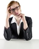 Thinking redhead businesswoman looking puzzled Stock Images