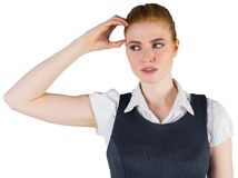 Thinking redhead businesswoman scratching head Royalty Free Stock Image