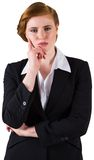 Thinking redhead businesswoman in suit Royalty Free Stock Photo