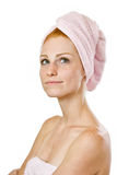 Thinking redhead woman in towel Royalty Free Stock Photography
