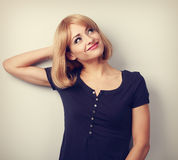 Thinking relaxing casual woman looking up with happy smiling Royalty Free Stock Photo