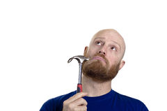 Thinking repairman Royalty Free Stock Images