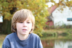 Thinking sad boy. Face of a little sad boy being thinking Royalty Free Stock Image