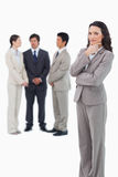 Thinking saleswoman with team behind her Royalty Free Stock Photos