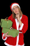 Thinking santa girl with gifts Stock Photo